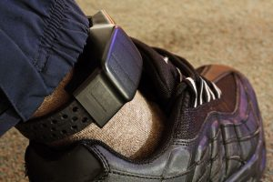 Man on house arrest wearing ankle monitoring device